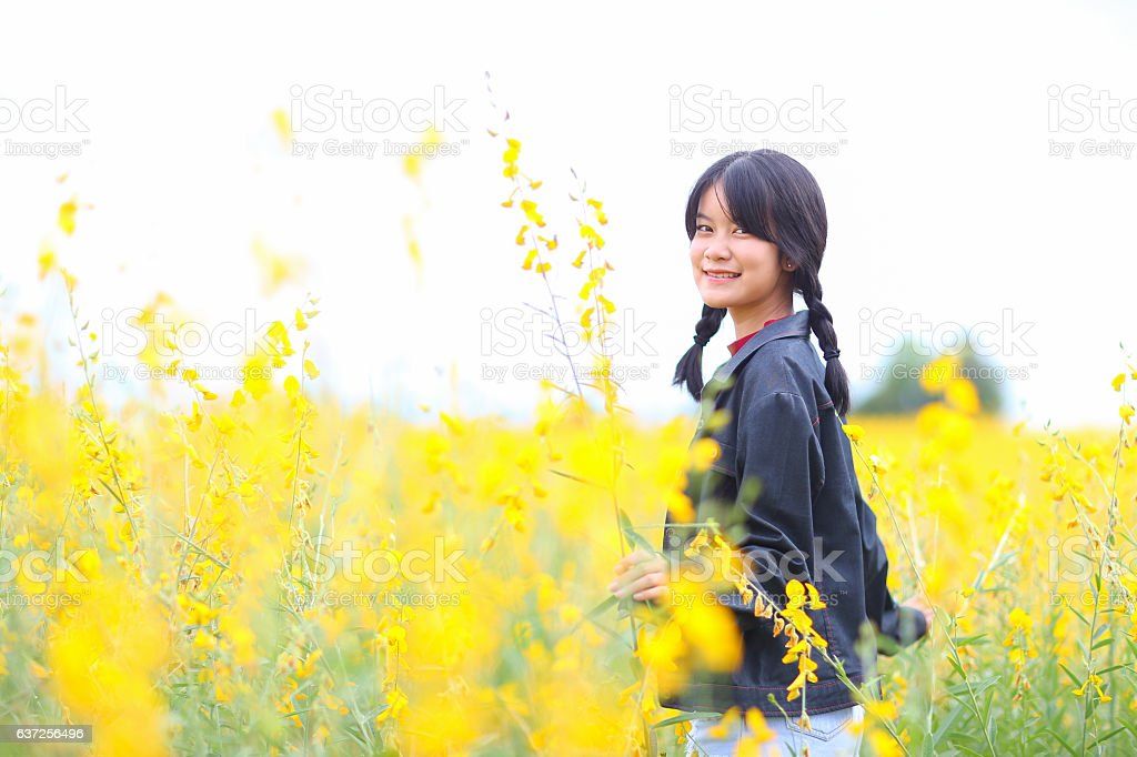 Portrait of the beautiful girl with yellow flowers,sunny summer stock photo