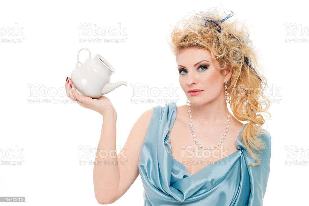 Portrait of the beautiful woman with a teapot stock photo