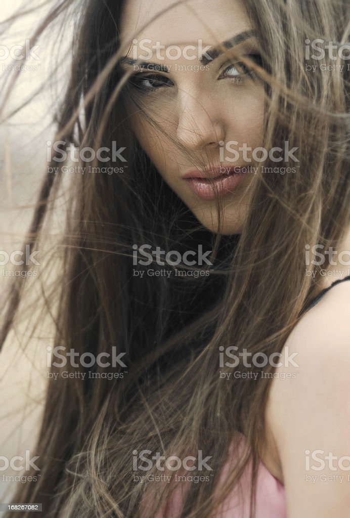 Portrait of the beautiful young girl with luxury brunet hair stock photo