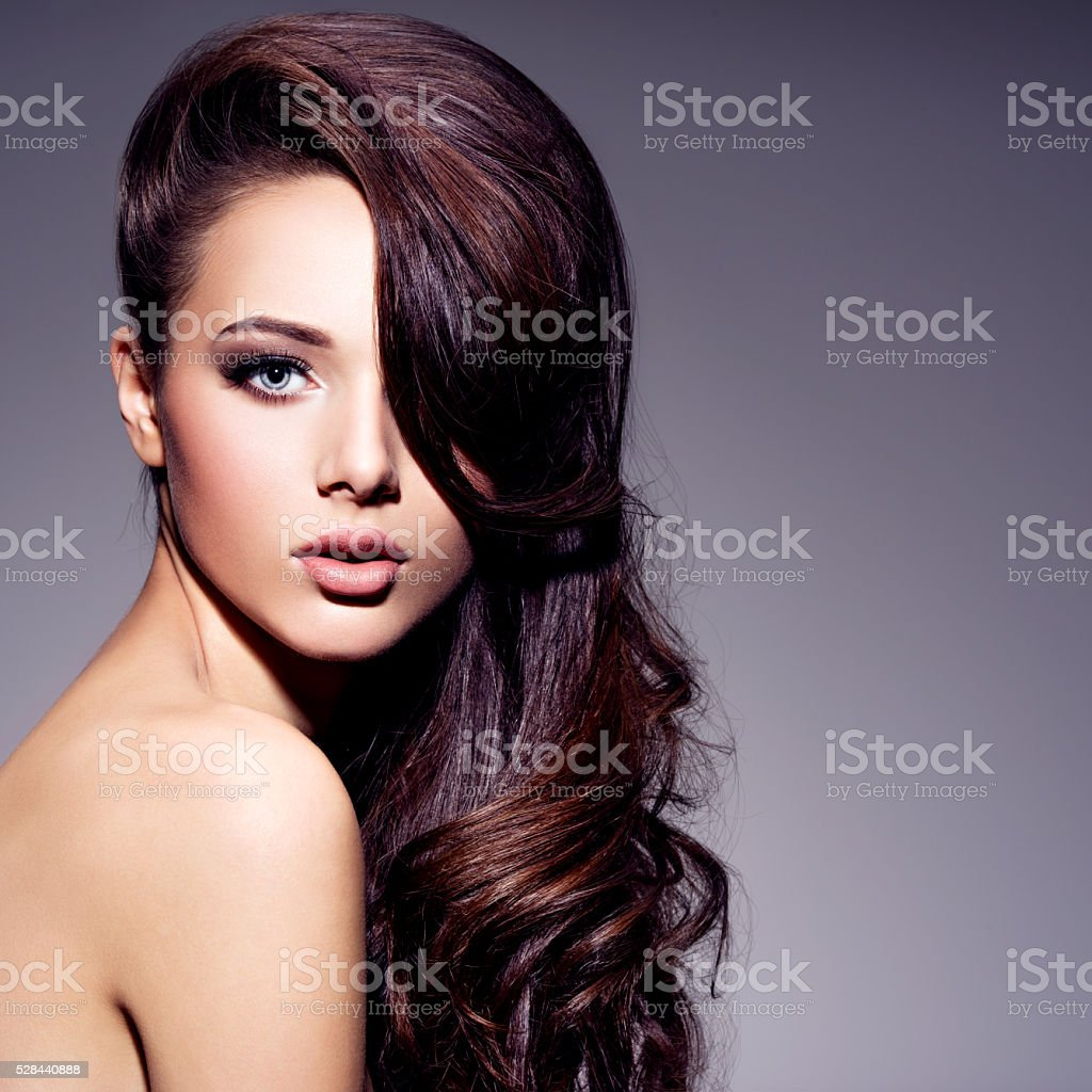 Portrait of the beautiful  young woman with long brown  hair stock photo