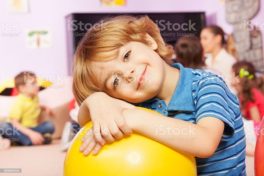 Portrait of the boy in kindergarten group stock photo