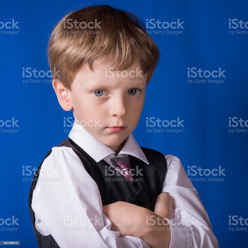 Portrait of the boy of the blonde with blue eyes stock photo