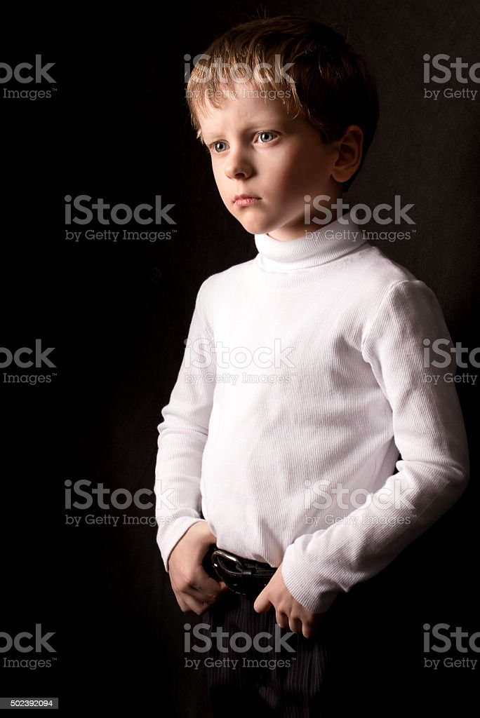 Portrait of the boy on a black background stock photo