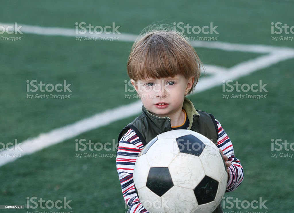 Portrait of the boy with a ball royalty-free stock photo