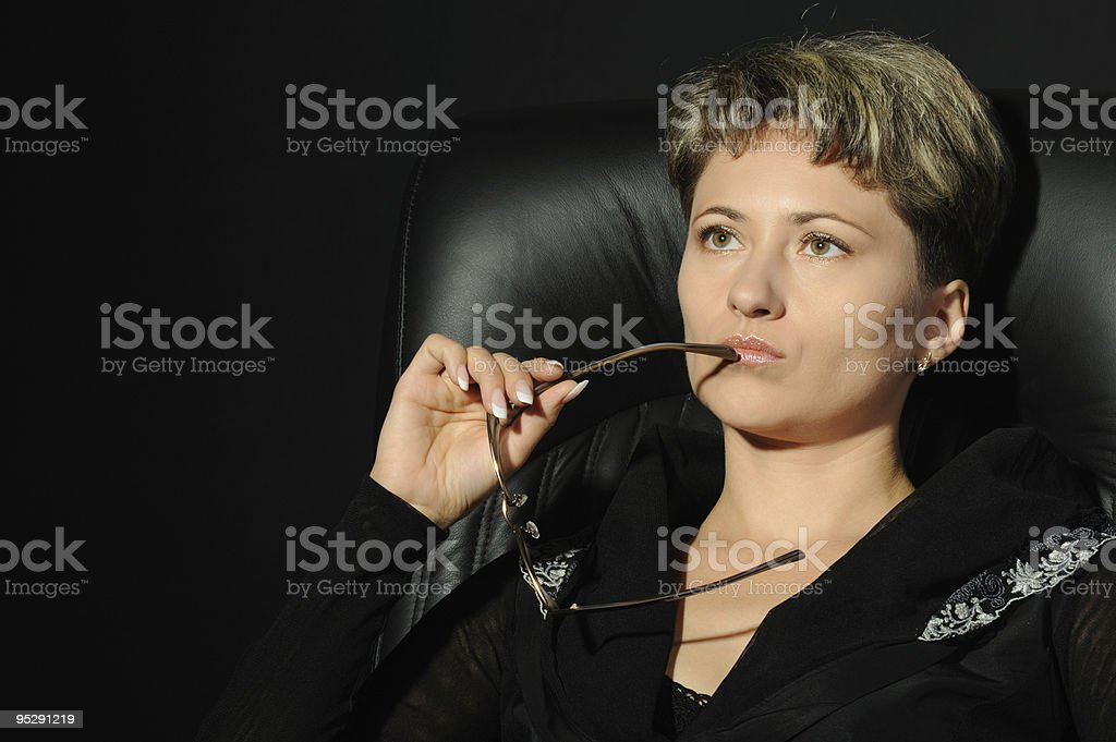 Portrait of the business woman in a leather armchair royalty-free stock photo