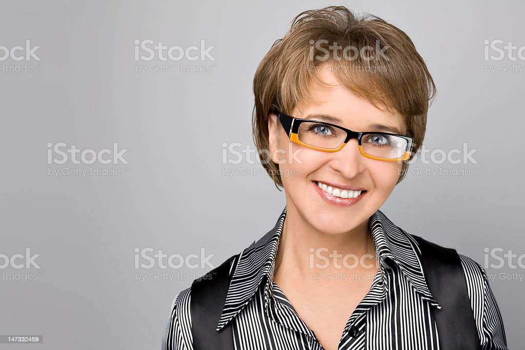 Portrait of the business woman in glasses royalty-free stock photo