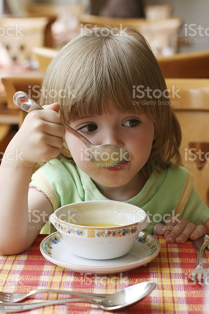 Portrait of the charming little girl during  dinner royalty-free stock photo