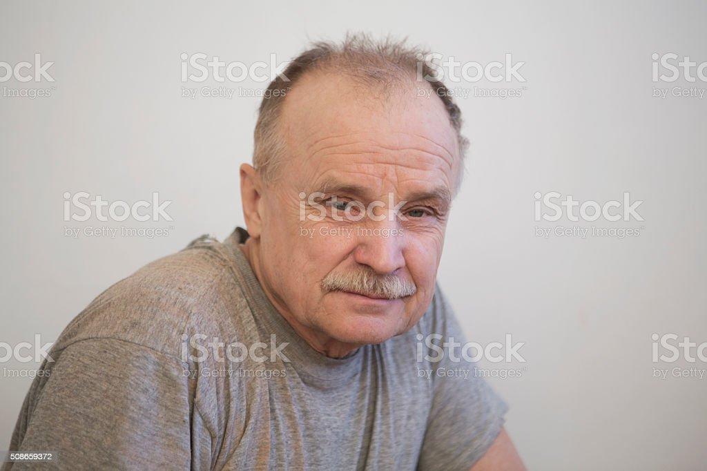 portrait of the elderly serious man stock photo