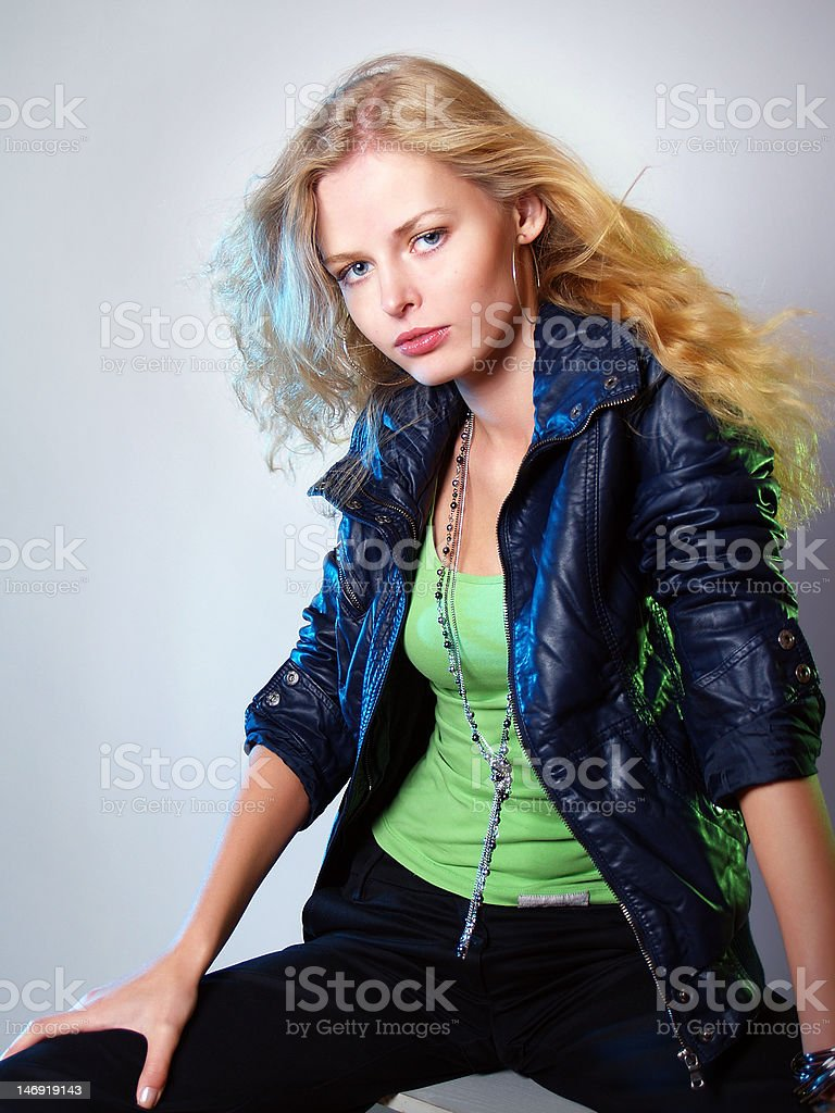 portrait of the fashionable girl in a leather jacket stock photo
