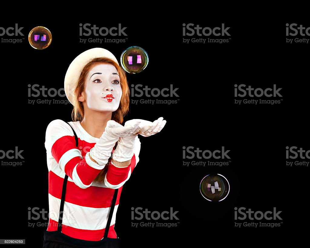 Portrait of the female MIM comedian catches bubbles, isolated on stock photo