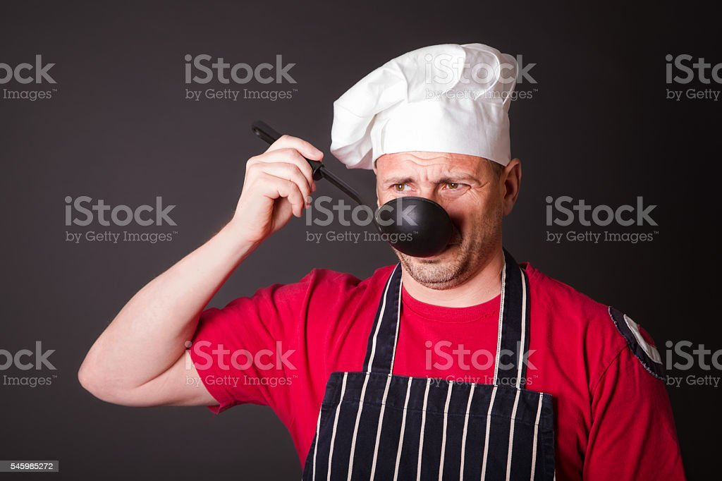 Portrait of the funny cook with a ladle stock photo