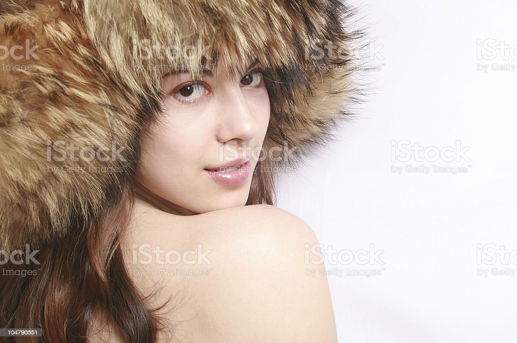Portrait of the girl in a fur cap. royalty-free stock photo