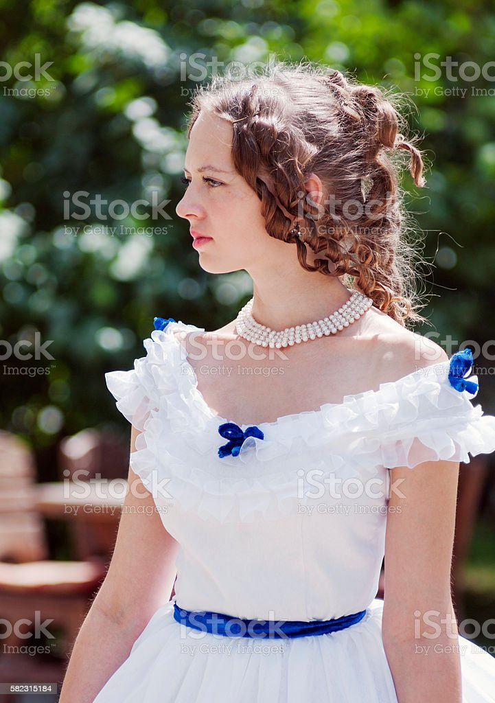 Portrait of the girl in an old ball gown stock photo