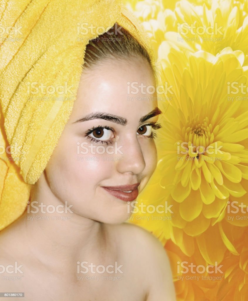 portrait of the girl on background of the yellow chrysanthemums stock photo