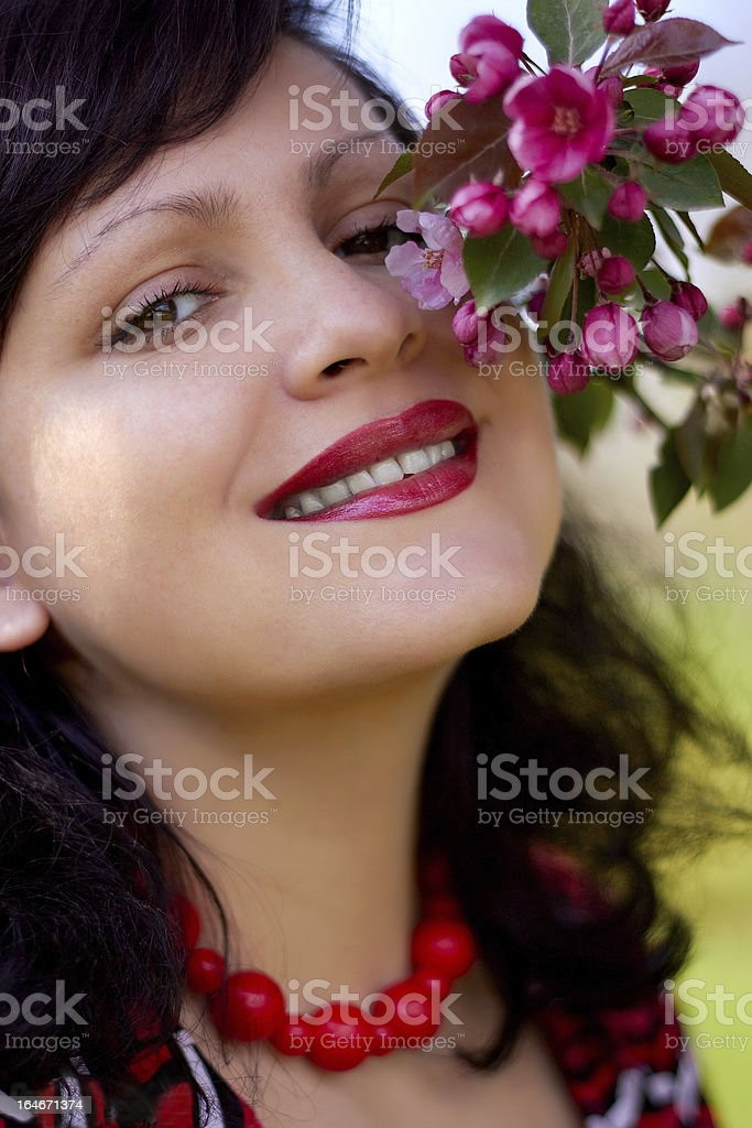 Portrait of the girl with a blossoming branch royalty-free stock photo