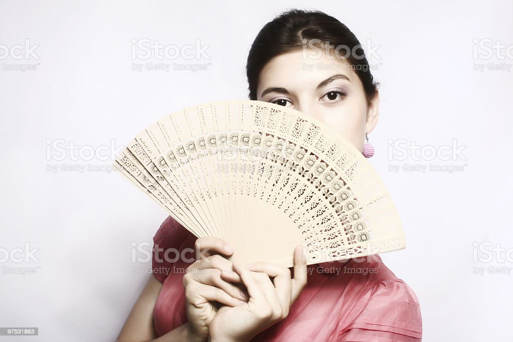 Portrait of the girl with a fan. royalty-free stock photo