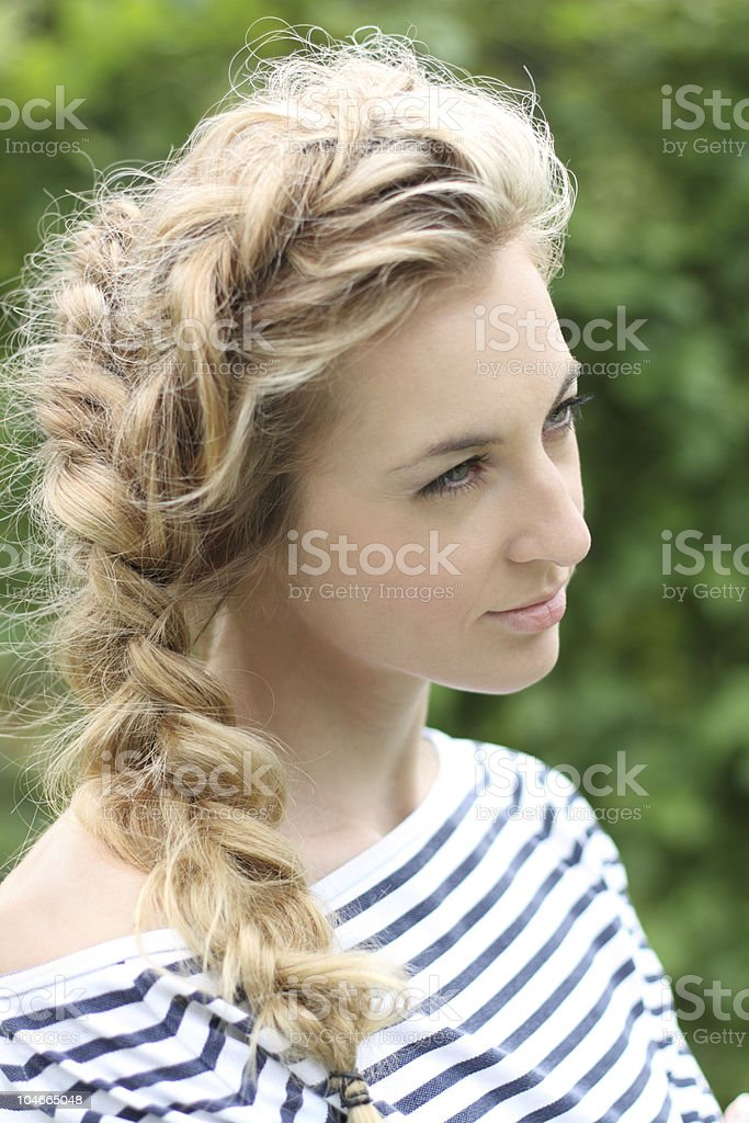 Portrait of the girl with a plait royalty-free stock photo
