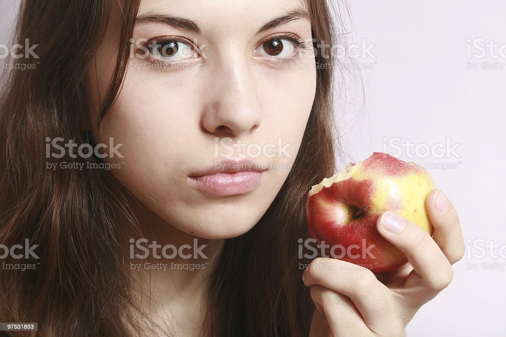 Portrait of the girl with an apple. royalty-free stock photo