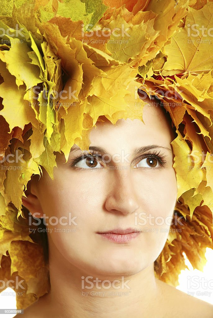 Portrait of the girl with leaves stock photo