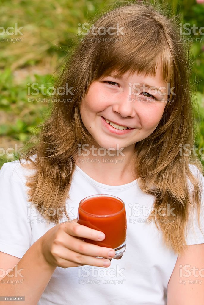 Portrait of the girl with tomato juice royalty-free stock photo