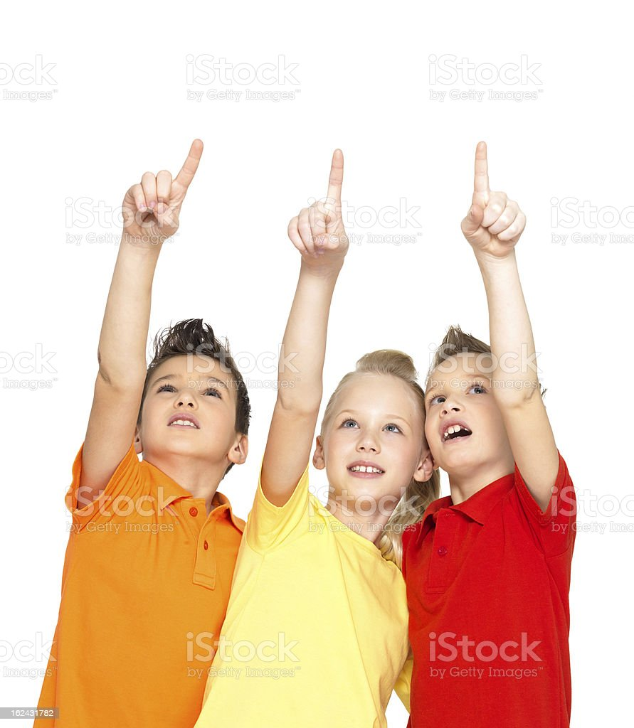 Portrait of the happy children point up  by finger stock photo