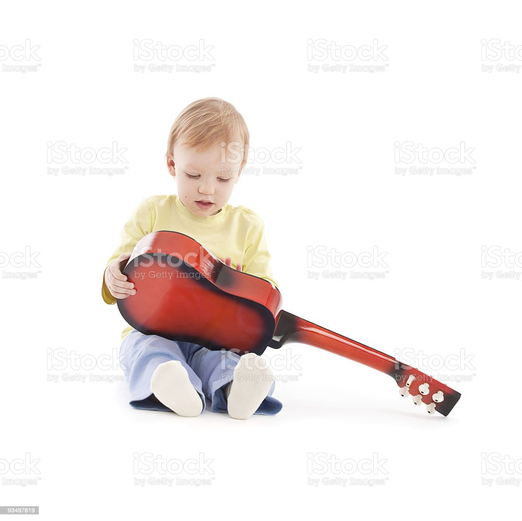 Portrait of the little boy with acoustic guitar royalty-free stock photo