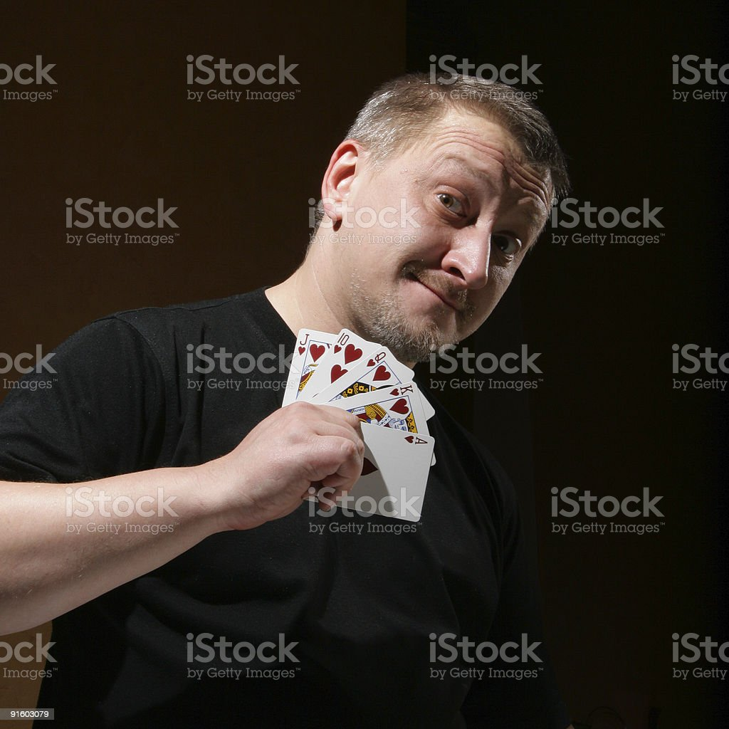 Portrait of the man with royal flush royalty-free stock photo