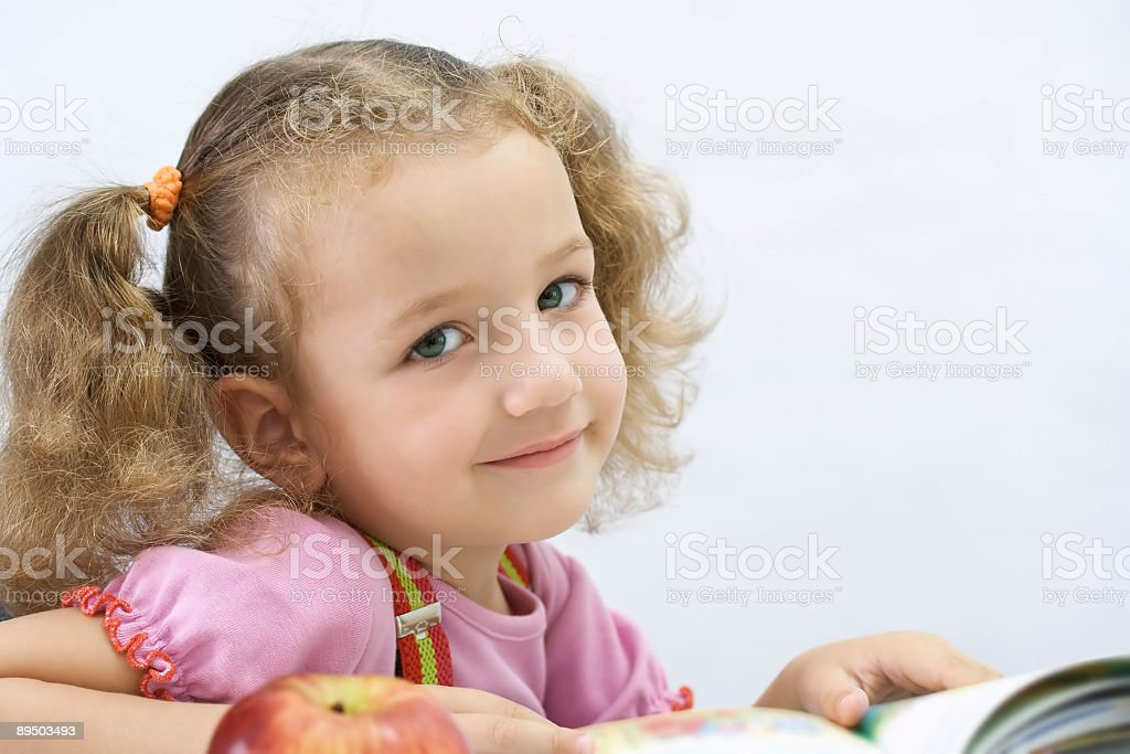 Portrait of the nice girl with book, over white royalty-free stock photo