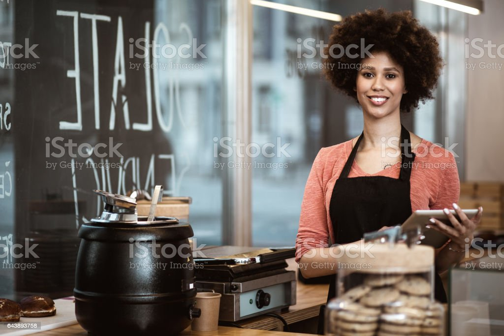 Portrait of the owner of a small take away business stock photo