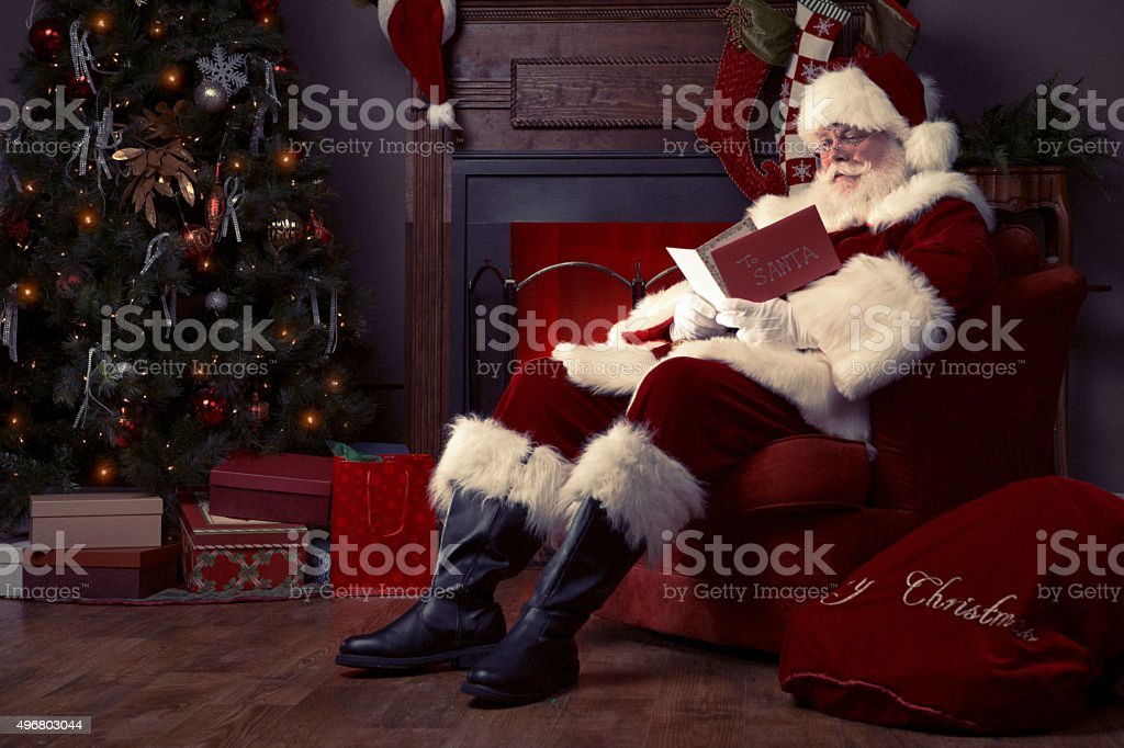 Portrait of the Real Santa Claus reading Christmas Card stock photo