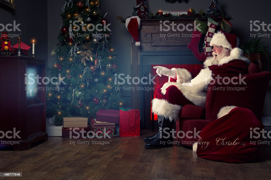 Portrait of the Real Santa Claus watching TV stock photo