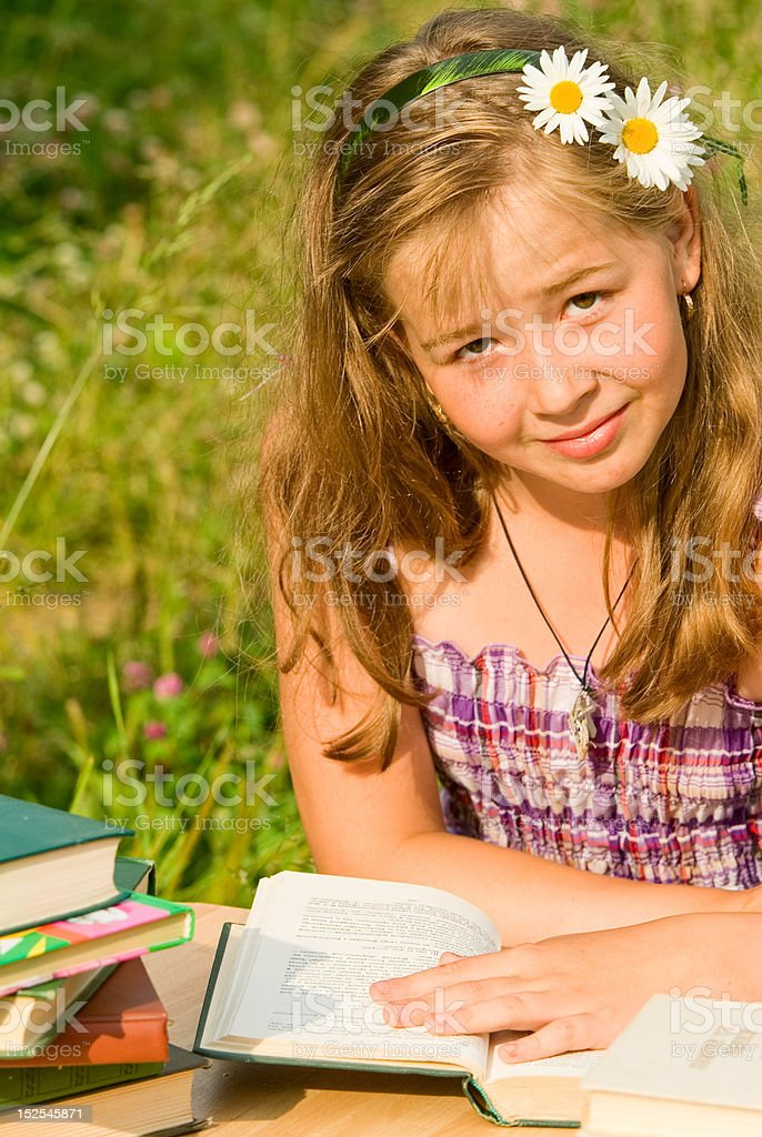 Portrait of the schoolgirl on summer vacations royalty-free stock photo