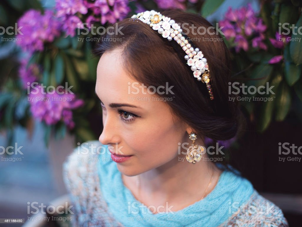 Portrait of the vintage woman with a headband stock photo