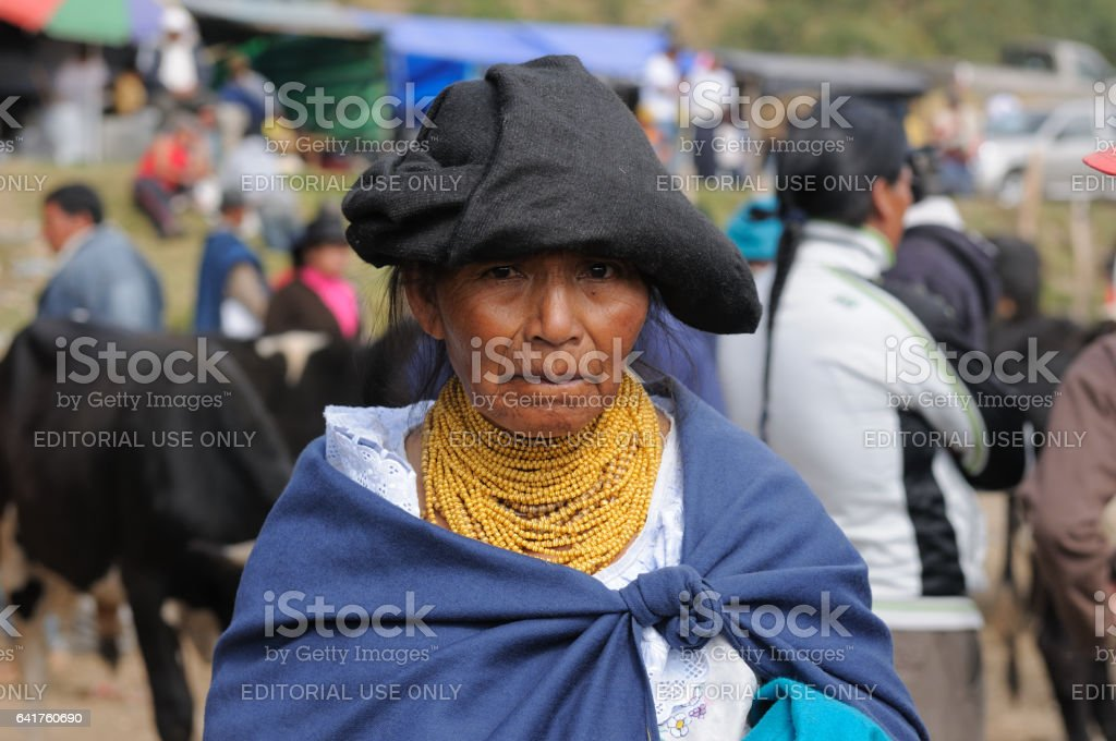 Portrait of the woman in traditional clothes and gold beads on the market stock photo