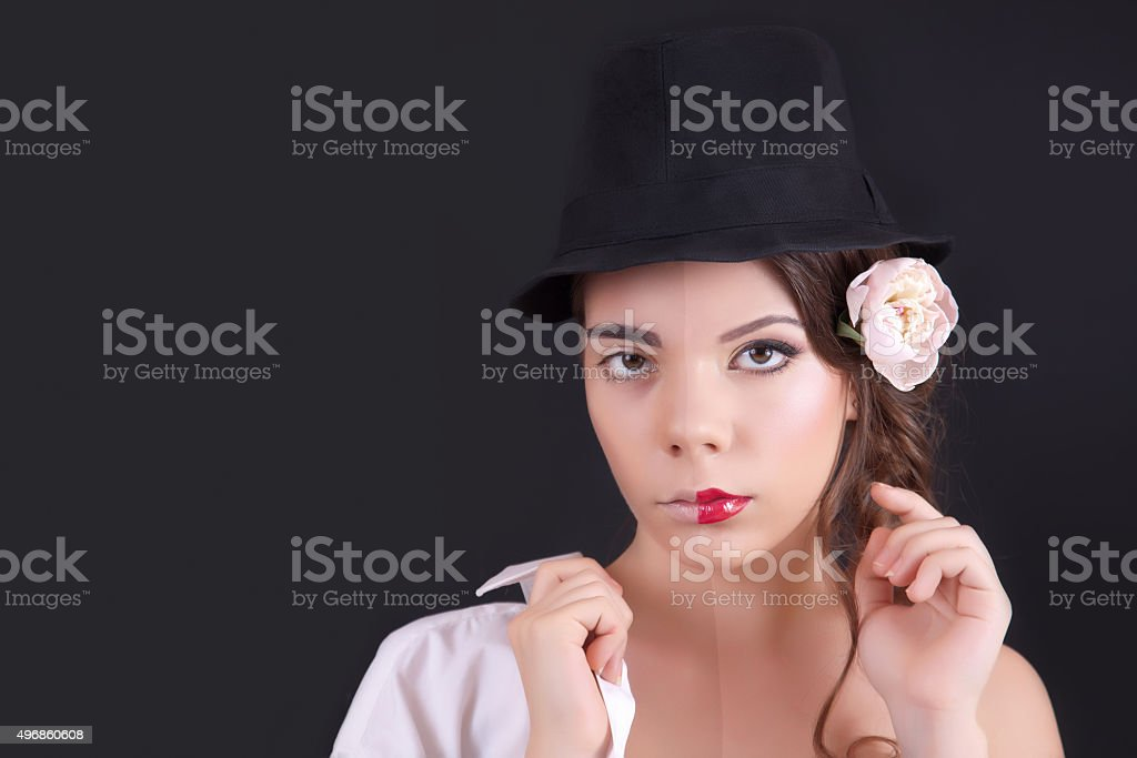 Portrait of the woman with a theatrical makeup stock photo