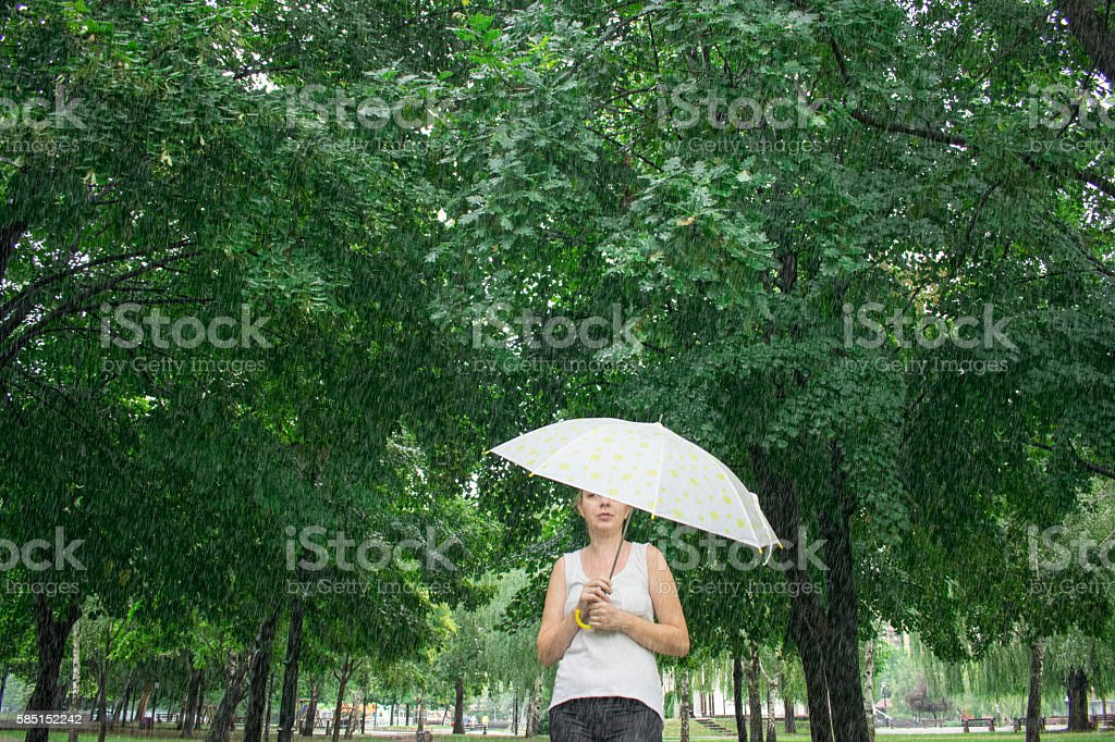 Portrait of the woman with umbrella stock photo