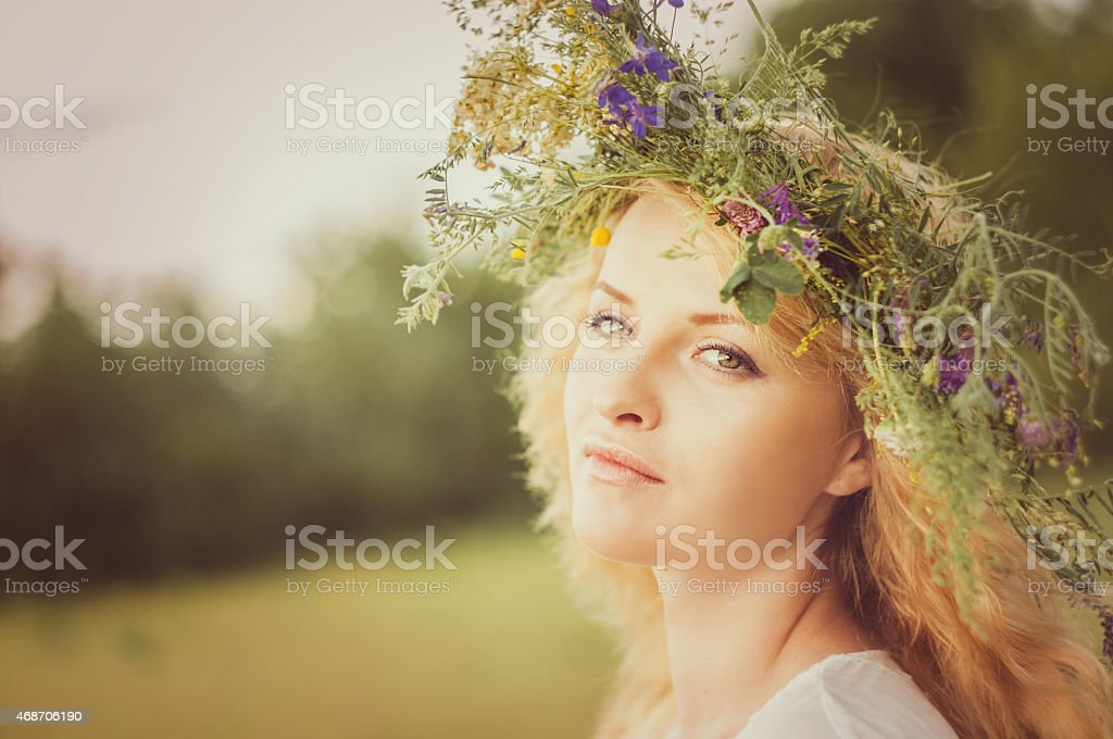 Portrait of the young beautiful woman stock photo