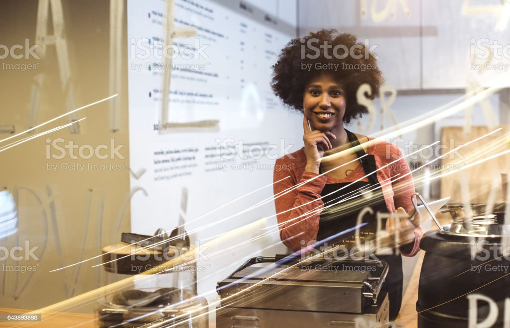 Portrait of the young owner of a small take-away business stock photo