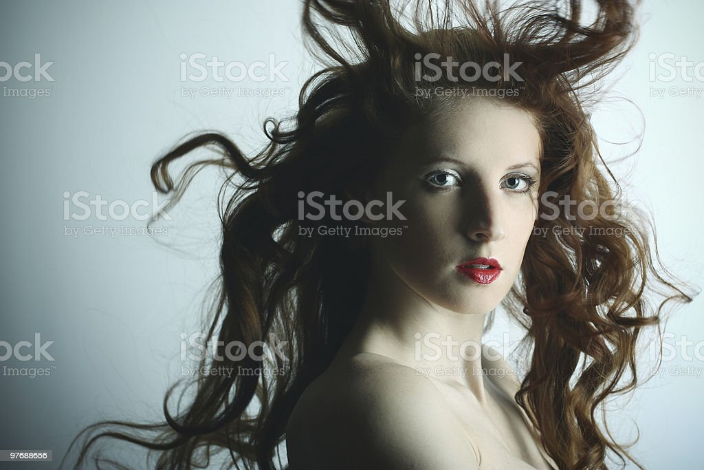 Portrait of the young sexy girl stock photo