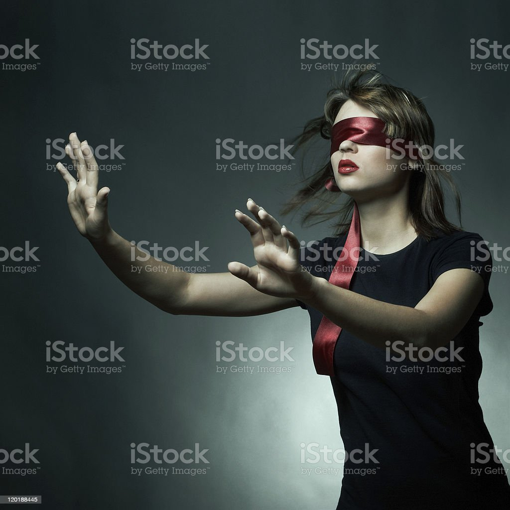 Portrait of the young woman blindfold stock photo