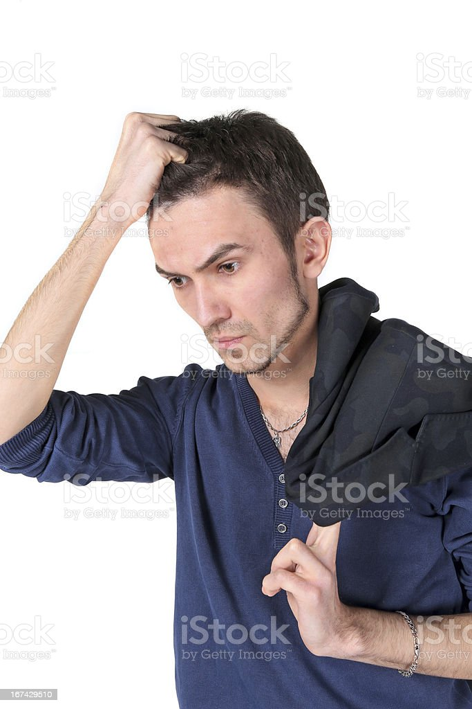 Portrait of  thinking young man stock photo