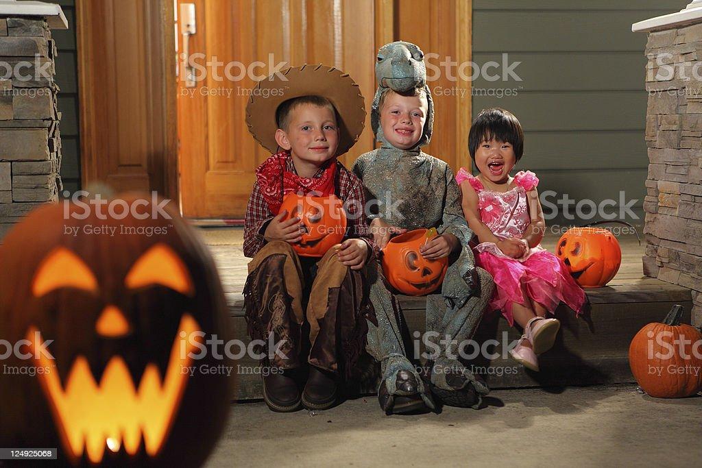 Portrait of three children in Halloween costumes stock photo