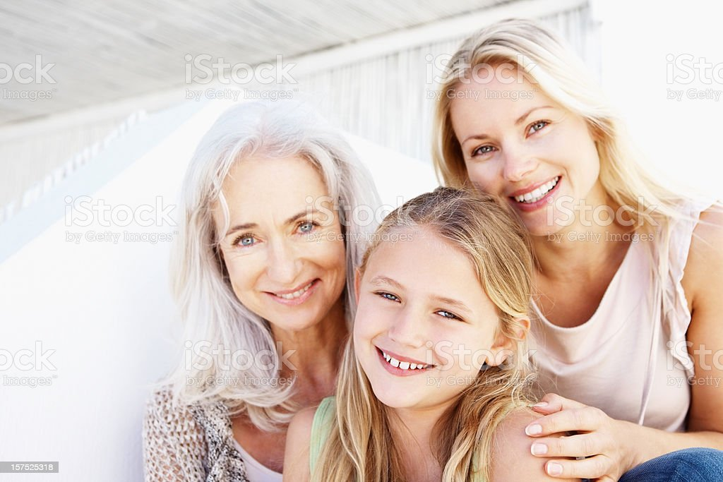 Portrait of three generational family smiling royalty-free stock photo