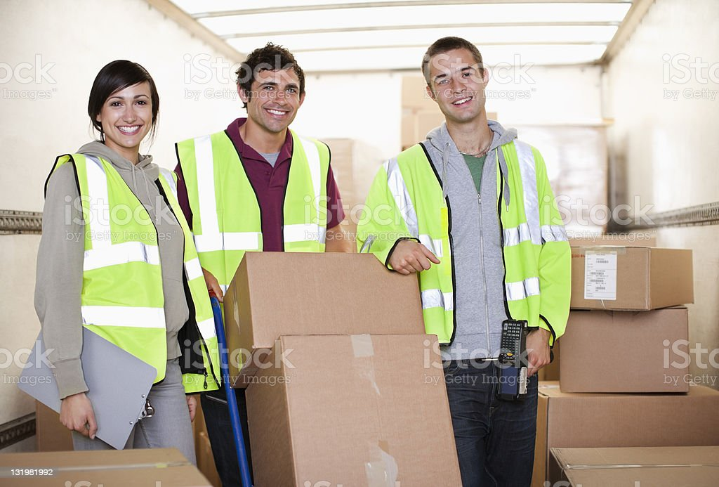 Portrait of three workers team in warehouse stock photo