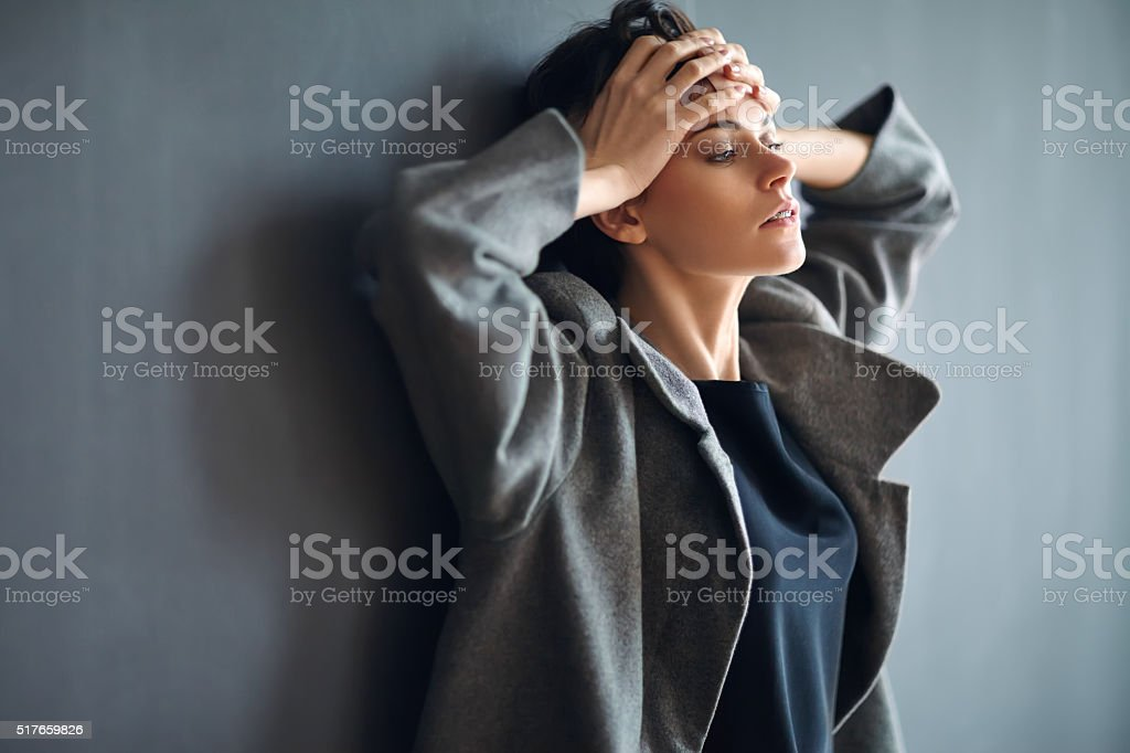 Portrait of tired beautiful woman on dark background stock photo