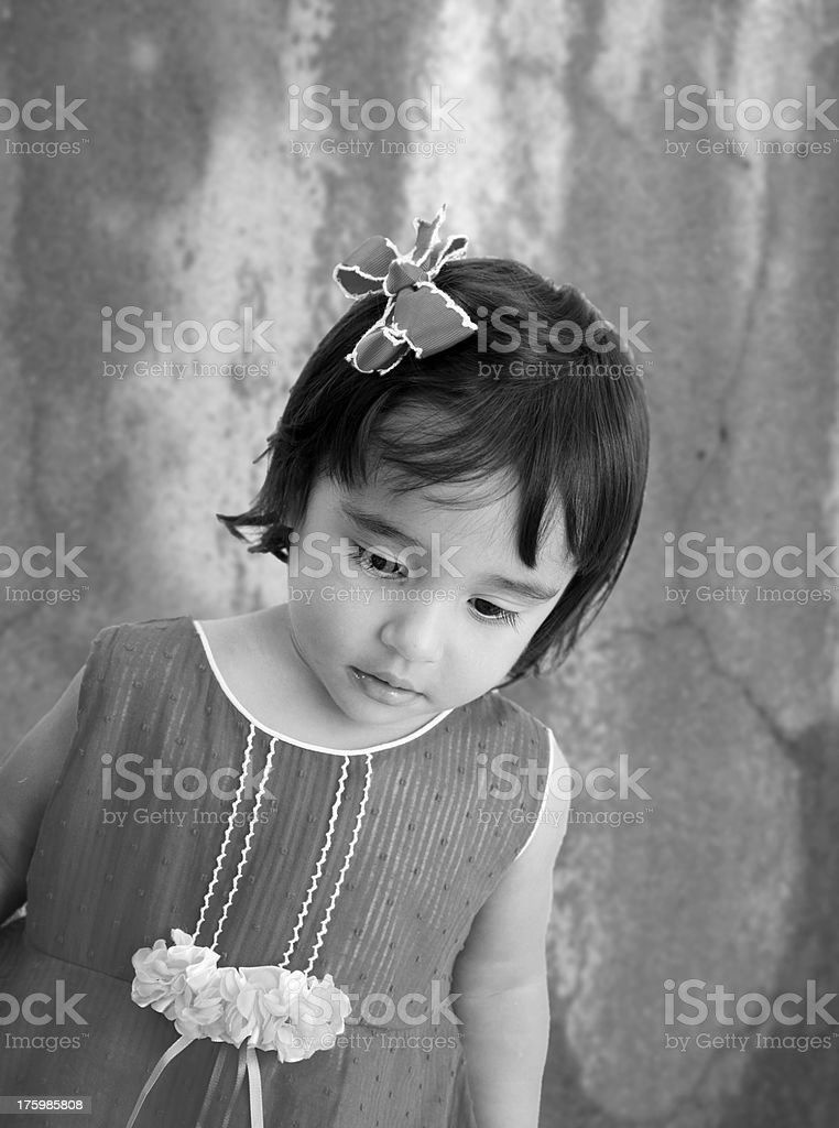 portrait of tired little girl with sad eyes. stock photo