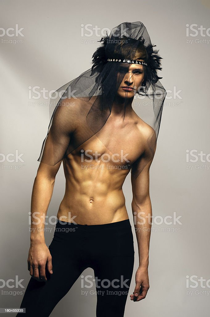portrait of topless boy with interesting hair stock photo