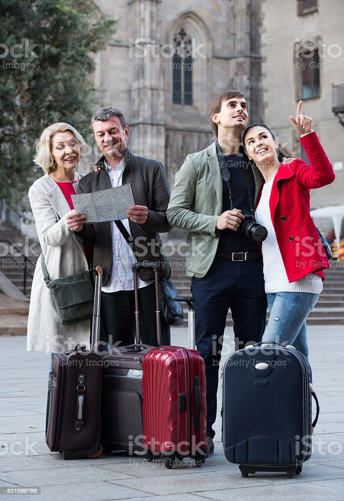 Portrait of tourists with map and baggage seeing the sights stock photo