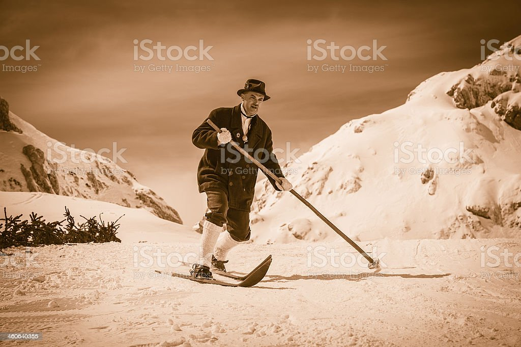 Portrait of Traditional Vintage Skier in the Mountains royalty-free stock photo