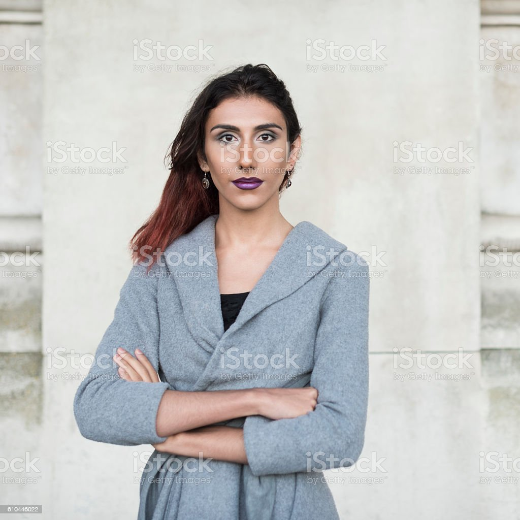 Portrait of transgender female facing camera, arms folded stock photo